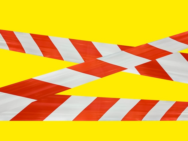 Red and white lines of barrier tape prohibit passage.
