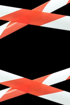 Red and white lines of barrier warning tape forbids passage