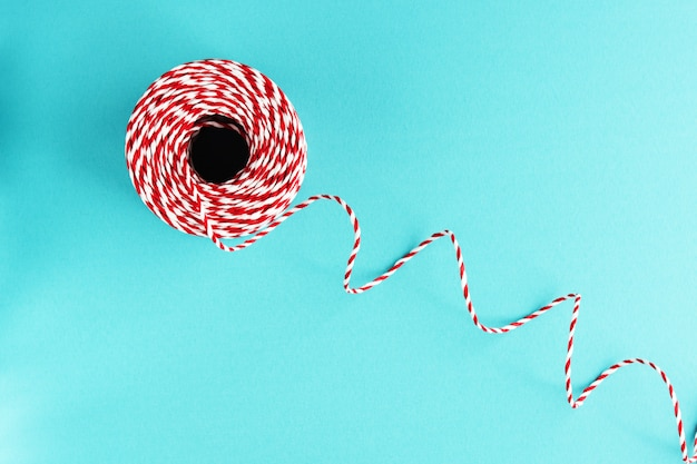Red white packing christmas rope on blue background