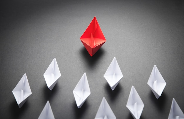 Red and white paper boat. leadership concept