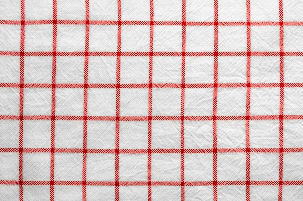 Red and white patterns scottish fabric background.