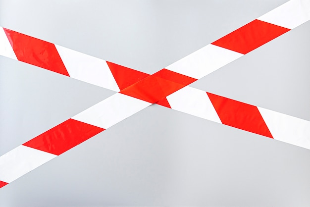 Red white signal striped interdictory tape. striped line isolated. plastic warning tape.