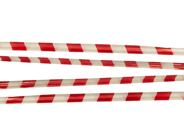 Red and white warning lines of barrier tape prohibit passage. barrier tape on white isolate. barrier that prohibits traffic. danger unsafe area warning do not enter. concept of no entry. copy space