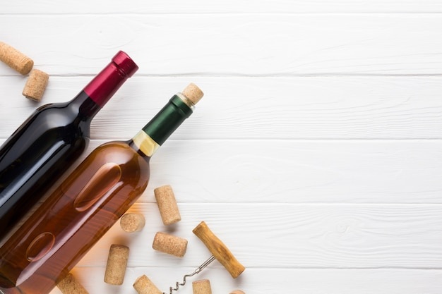Red and white wine with corks