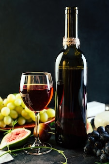 Red wine in a bottle on a black surface