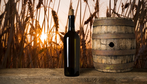 Red wine bottle on a wheat background