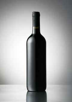 Red wine bottle with a blank label for branding