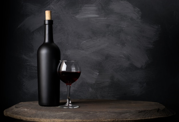 Red wine bottle on wood