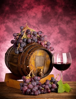 Red wine glass barrel with grapes