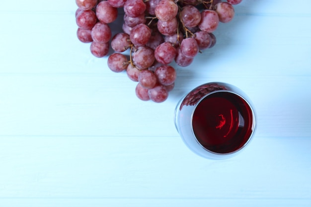Red wine and grapes on the table top view