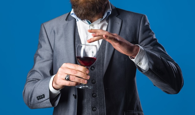 Red wine man in suit drinks wine alcohol wine glass of wine man with bordeaux tasting alcohol