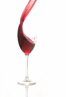 Red wine poured from a glass