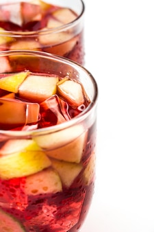 Red wine sangria in glass isolated on white table