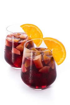 Red wine sangria in glass isolated on white