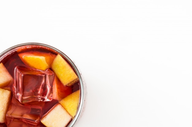 Red wine sangria in glass on white