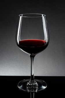 Red wine in wine glass isolated