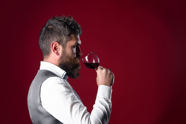 Red wine wine glass tasting alcohol bearded man with glass of wine man drinks red wine man with