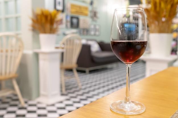 Red wine on wooden table in restaurant for dinner