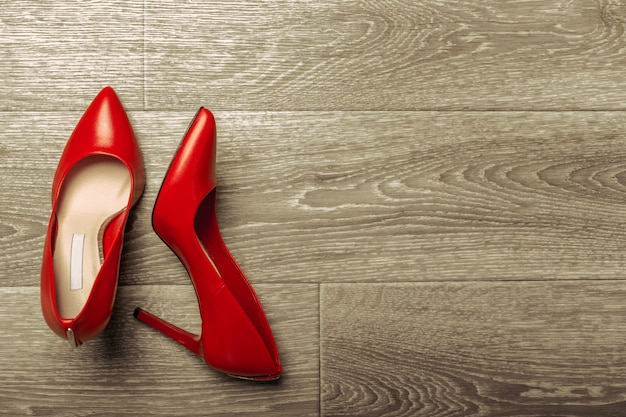 Red women shoes on wooden table
