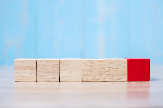 Red wooden block on the building. business planning, risk management