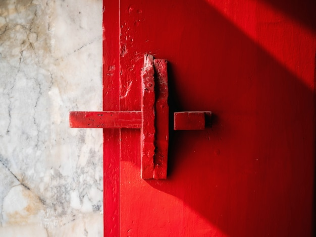 Red wooden door and wood latch and handle