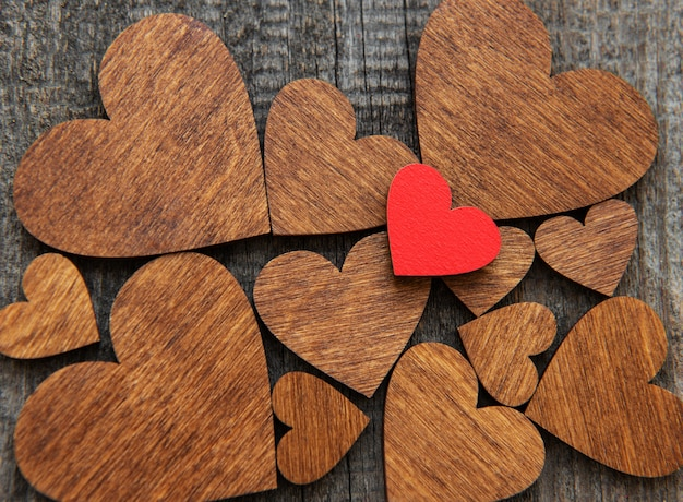 Red wooden heart on a wooden heart