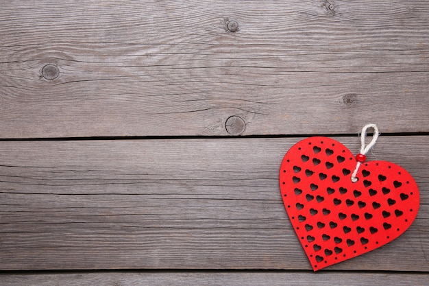 Red wooden hearts on wooden background