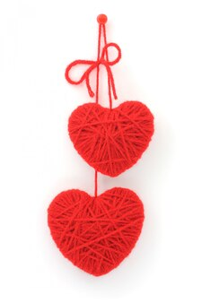 Red woolen hearts isolated on white background