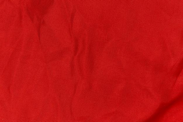 赤いしわ生地のテクスチャ