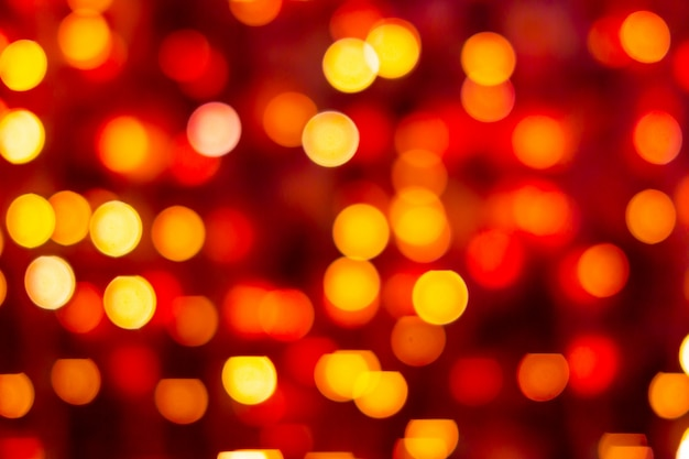 Red and yellow abstract background with bokeh defocused blurred lights