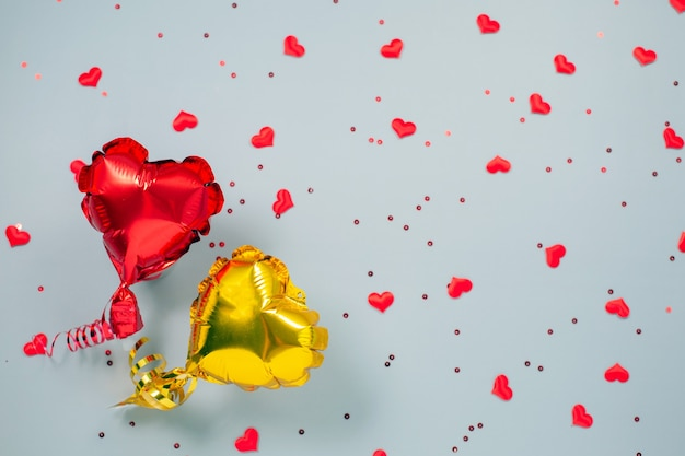 Red and yellow air balloons of heart shaped foil on festive.