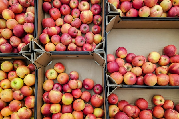 Red and yellow apples in box