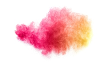 Red yellow color powder explosion on white background.