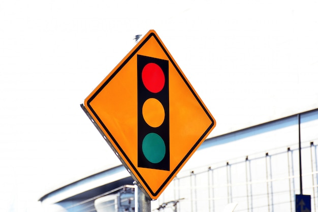 Red yellow and green sign label of traffic light on the road in the city
