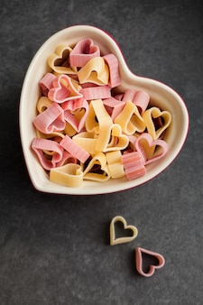 Red and yellow heart shaped pasta