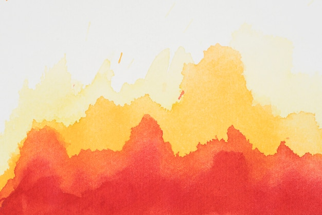Red and yellow mix of paints on white paper
