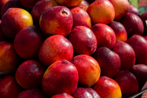 Red-yellow nectarines on counter of farmers' market selective focus