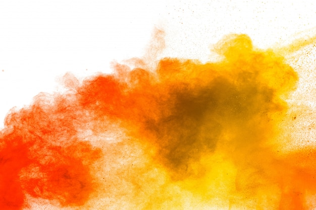 Red yellow  powder explosion on white background.red yellow color dust splash clouds.