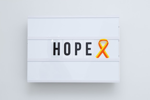 Red-yellow ribbon as symbol awareness of world hepatitis day on lightbox