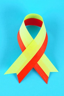 Red yellow ribbon on blue table.