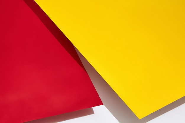 Red and yellow shadow-casting sheets of paper