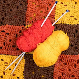 Red and yellow yarn on wool pattern