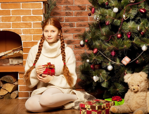 Redhair woman with christmas gift