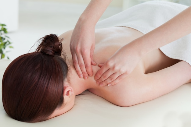 Redhaired woman having a rolling massage