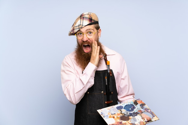 Redhead artist man with long beard holding a palette