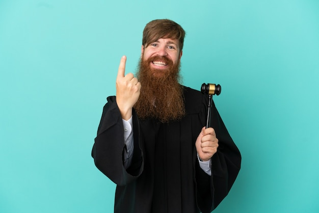 Redhead caucasian judge man isolated on blue background doing coming gesture