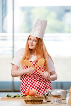 Redhead cook working in the kitchen