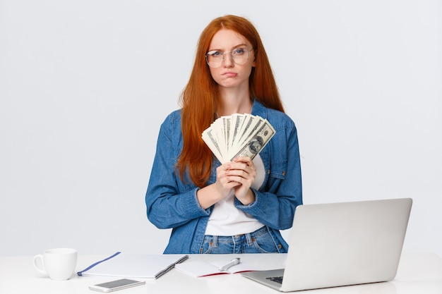 Redhead female with banknote fan