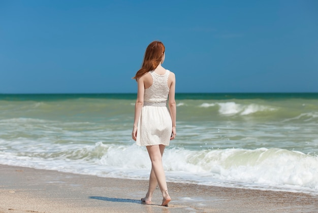 Redhead girl on the beack in spring time