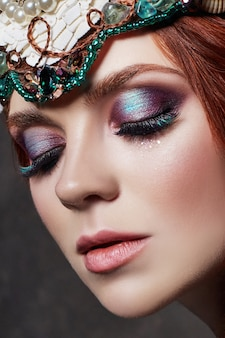 Redhead girl with bright makeup and big lashes